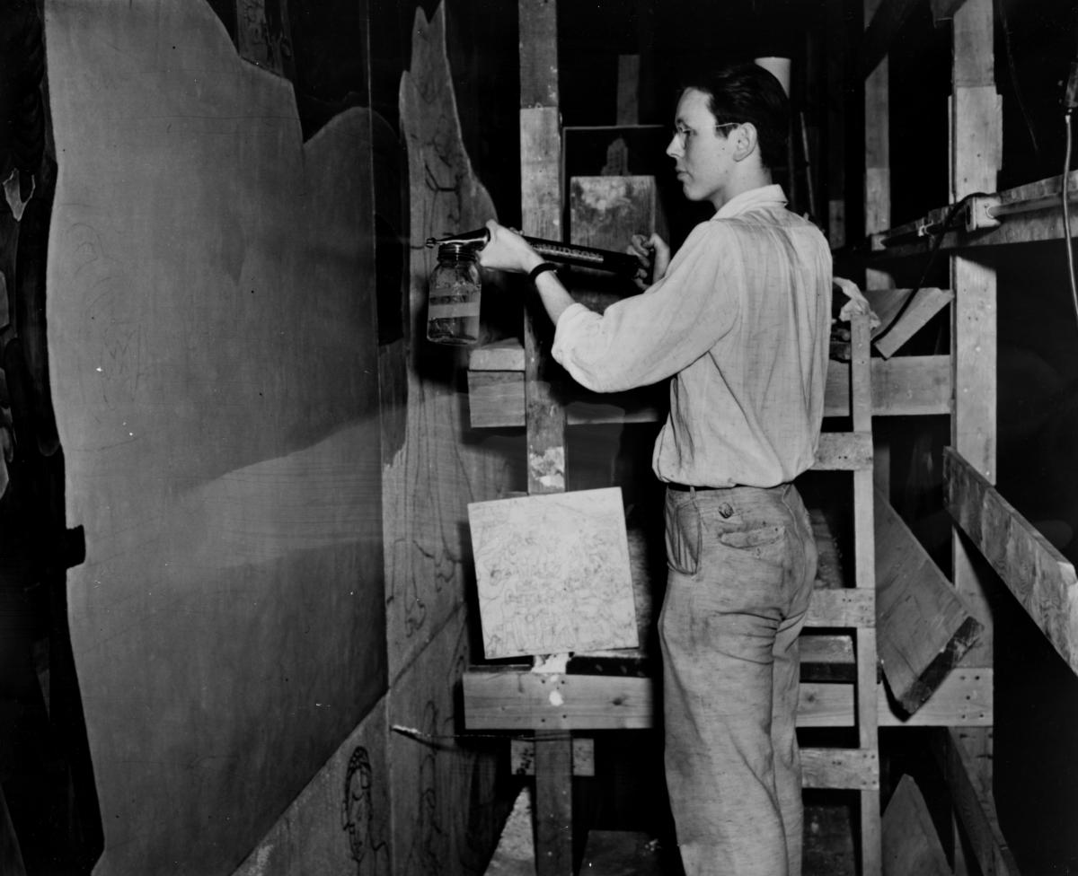Wayne Lammers spraying a concoction of 50% Butanol, 50% Water, which retarded the drying time of the plaster to 18 hours. WPA Photo.