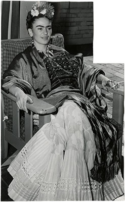 Kahlo sitting in a chair
