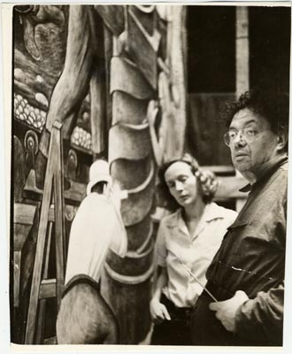 Diego rivera in front of mural with