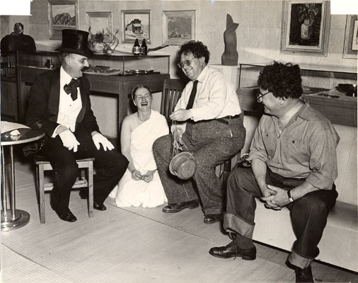 "Ansel Adams, Mona Hofmann as the ""Lady in White"", Rivera as himself, and Pflueger as ""Rivera"""